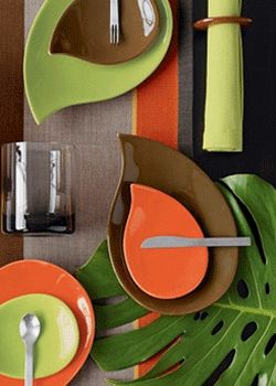 Dinnerware in brown, orange and sage green...love these colors!