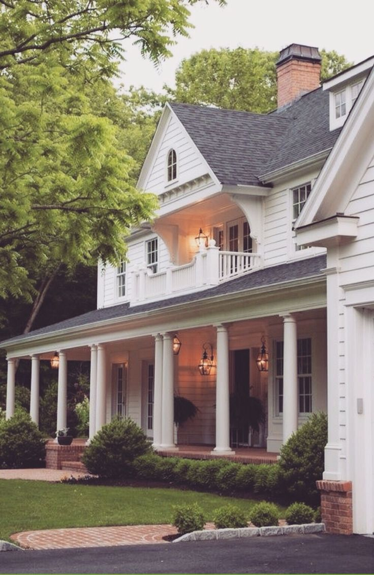 Add pillars and remove railing to open up front porch More