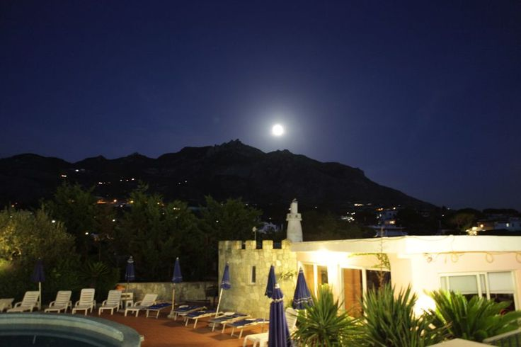 The moon rises from the Mount Epomeo. Made by Sergio