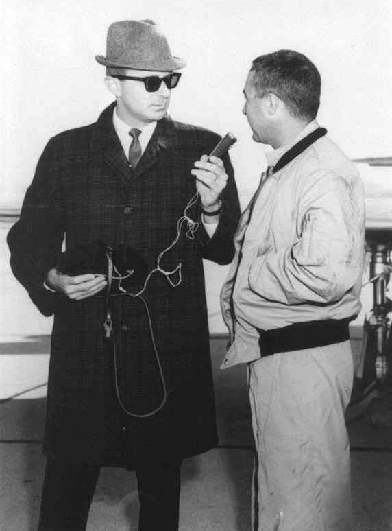 Long time Columbus, Indiana radio broadcaster, Sam Simmermaker, who is in his fifth decade of broadcasting at WCSI Radio, interviewing Gus Grissom in this 1960s photograph. Gus had flown into Bakalar Air Force Base to park his T-33 overnight to visit his family in Mitchell, Indiana for Christmas.