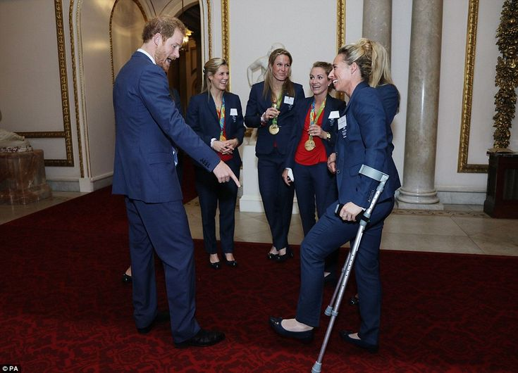 Prince Harry flirted up a storm with the Team GB women's hockey team and joked about one of the player's crutches as he joined the Queen and Duke and Duchess of Cambridge to honour the Olympic and Paralympic heroes at Buckingham Palace