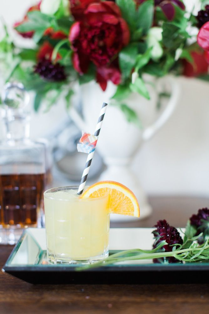 Preakness Stakes' Black Eyed Susan: Ingredients: 1 1/4 oz Bulleit Bourbon 3/4 oz vodka 3 oz sweet and sour mix 2 oz orange juice  Combine all ingredients in a cocktail shaker with ice.  Shake vigorously and pour into a rocks glass.  Garnish with orange slice and cherry.