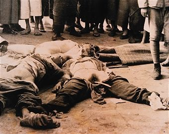 Chinese Victims with Japanese Soldier at Right, Nanking Massacre, circa 1937.
