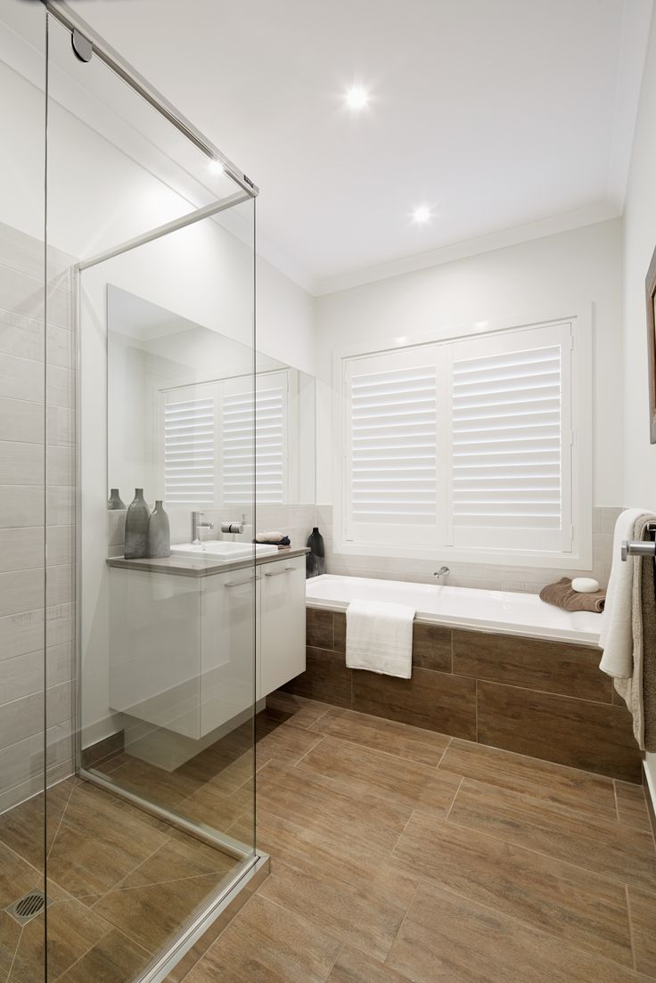 Crisp whites offset feature #timber grain #tiling.   View floor plans and custom designs for #Riviera33 http://www.boutiquehomes.com.au/home-design-group/riviera
