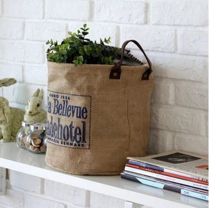 Keep dirty laundry out of sight because this Mediterranean Laundry Basket is the bomb!   The material is fabric, very handy, and can be placed anywhere in your home.  This eco friendly bag can be used as desktop organizer, toy, magazine and phone storage.