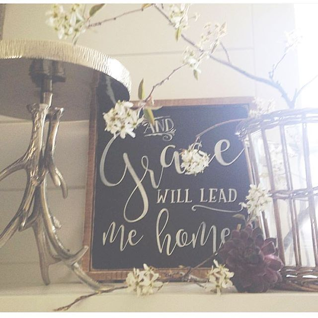 """Loving how Jodi @peppermintandgrapefruit used our """"Grace Will Lead Me Home sign in this sweet vignette.  Hopefully everyone is enjoying their Sunday afternoon! ☺️"""