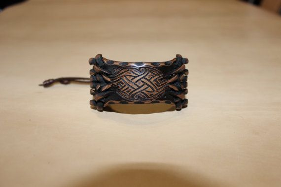leather bracelet with pattern and quirks.Made of от TheLostCraft