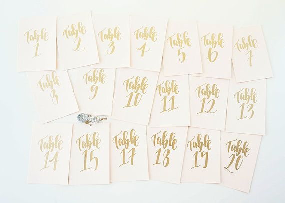 gold calligraphy wedding table numbers // handwriting in