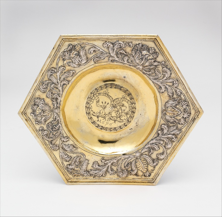 """Hungarian hexagonal dish 1696, Kingdom of Hungary / Transylvania.   Engraved armorial devices:  1] of arm holding three arrows inscibed """"SEREDI BENEDEK"""",  2] bird standing on flowers with an arrow in its neck inscribed """"UJLAKI BORBALA""""   The Metropolitan Museum of Art."""