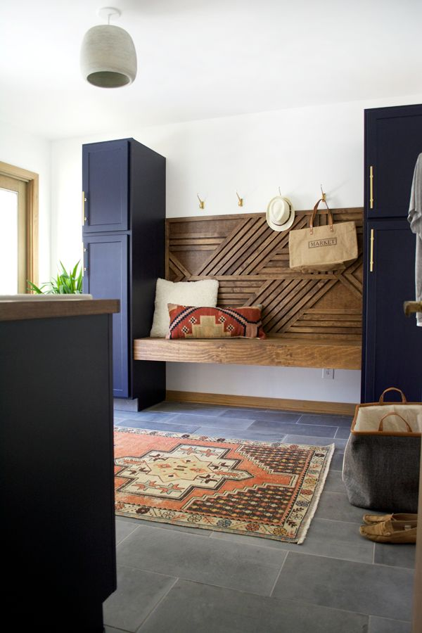 A dated space gets a dramatic update! You don't want to miss this Modern Navy Laundry Room reveal that doubles as a mud room as well!
