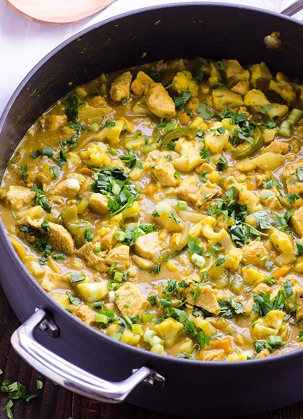 30 Minute Chicken and Cauliflower Yellow Curry Recipe -- Easy, healthy and budget friendly comfort food. Can be made vegan and it is gluten free. #cleaneating