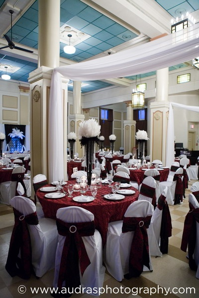 Red and black room decor inside Heritage Hall, Vancouver. Planning by Eventful Planners, decor by Niche Event Stylists.