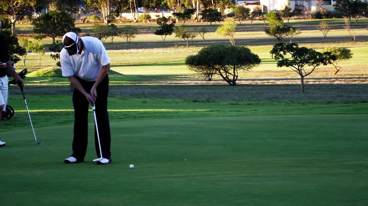 Putting on the 9th green late afternoon.