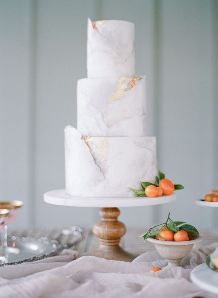 Three tier marble orange topped wedding cake: Photography: Jenny Soi - http://www.jennysoi.com/