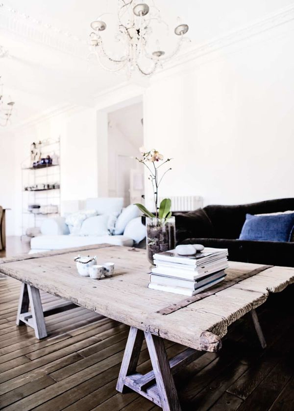 white & black couch, white chandelier & recycled wood vintage coffee table
