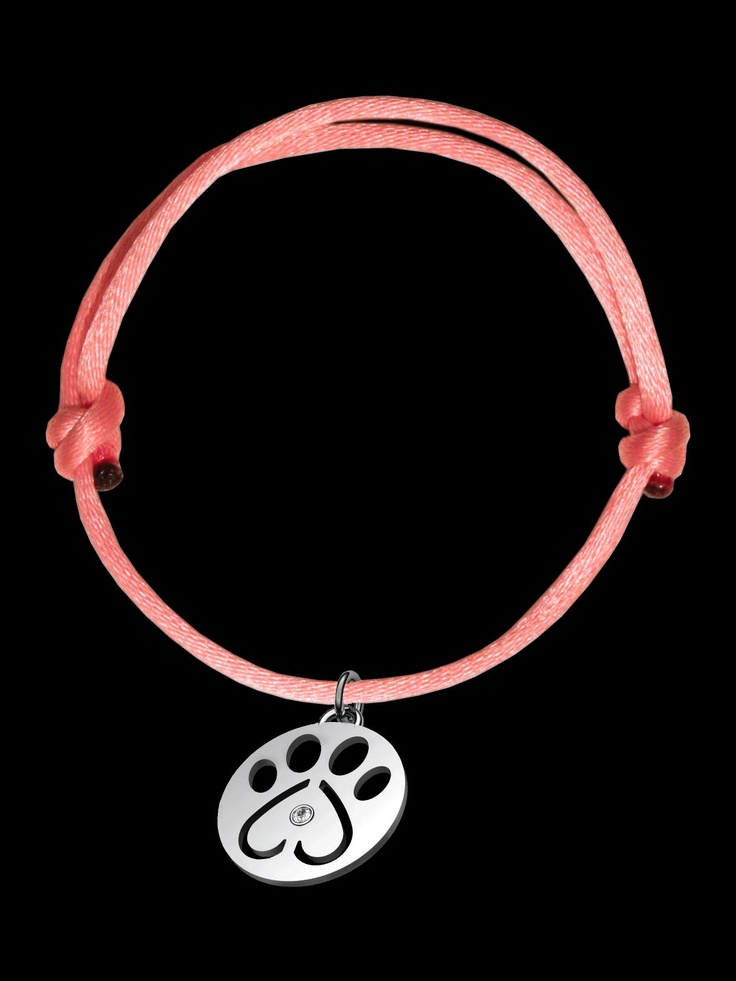 Our Cause For Paws Sterling Silver Diamond Paw Charm on Pink Cord Bracelet. Round Silver Paw Charm with One Diamond in Center on an Adjustable Pink Silk Cord. The Charm measures 19MM and the Total Diamond Weight is .02ctw. $100