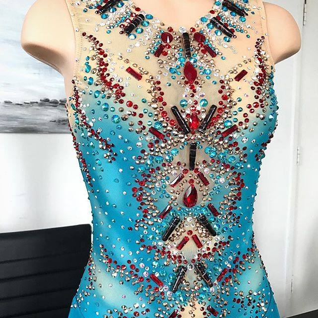 Close up of Joshi Helgesson's custom Long Program Dress by Lisa McKinnon💎Good Luck Joshi at European Championships 2017!!! 💥⭐💫 #lisamckinnon #costumedesigner #joshihelgesson #eurofigure #skatesweden #nationalchampion #figureskating #konståkning #sverige #sweden #custom #skating #dress #costume #african #music #inspired #teal #red #rosegold #africanbeads #modern #style #fashion #stylist #teamsweden