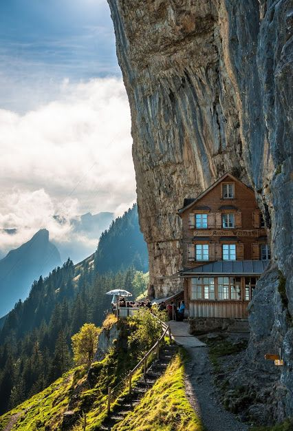 This fabulous and magnificent Aescher Hotel is located near Wildkirchli and just below the Ebenalp cliff. Ebenalp is the northernmost peak of the Appenzell Alps of Switzerland. Wildkirchli is a combination of three caves in the Alpstein massif of Appenzell. This marvelous mountain guest-house and hotel was built during 19th century.