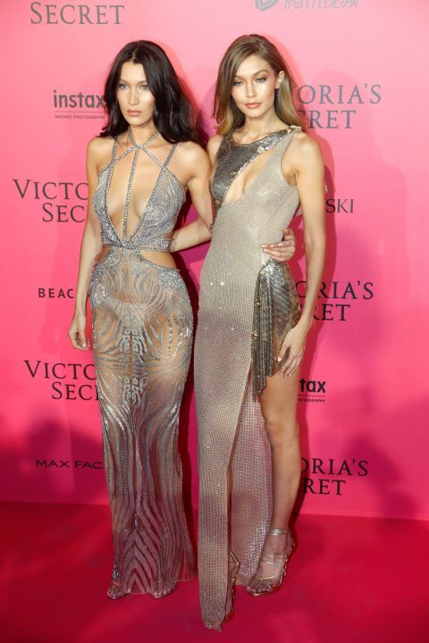 Bella and Gigi Hadid stunned in sparkles for the 2016 Victoria's Secret Fashion Show After Party!   Bella wears a Julien Macdonald dress and Messika jewelry; Gigi wears an Atelier Versace dress.