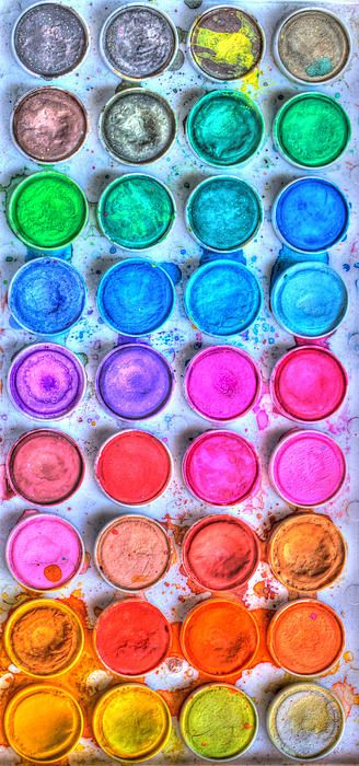 This is a picture of watercolors this picture has some warm colors for example (Red, Pink, and orange) and some cool colors like ( Green, Blue and purple) ~Holly Kell Art6/01