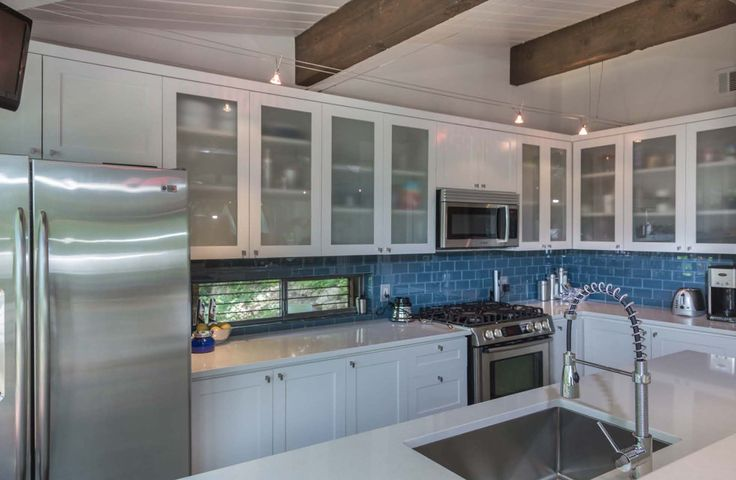 Frosted glass cabinets go well with white and stainless for White kitchen cabinets with frosted glass