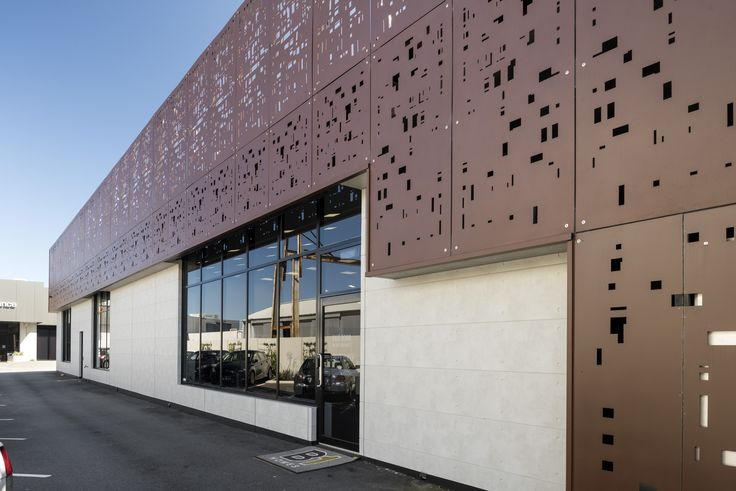 The raw concrete look of Territory Urban Grey product was used to create a clean and crisp contrast against the stunning red ochre metal feature in this Perth office space