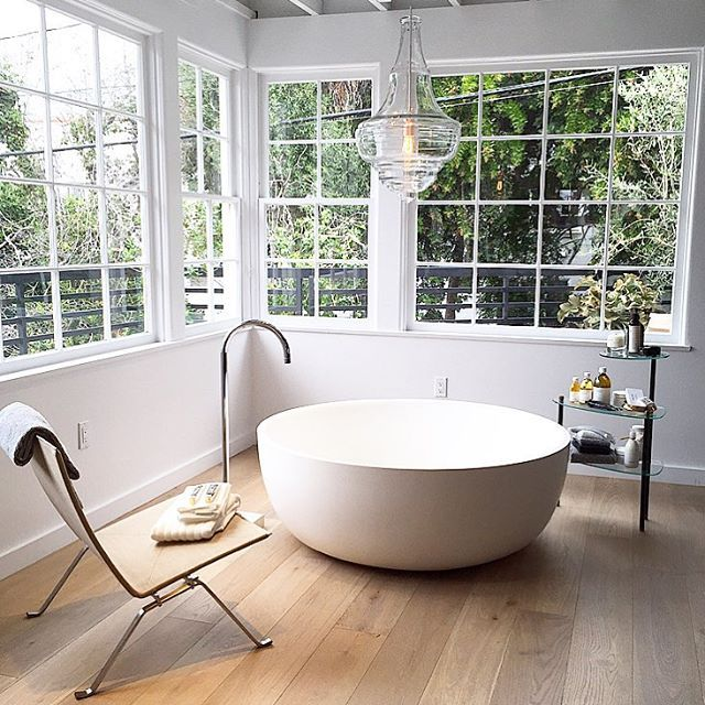 The LINE Apartment In Los Angeles We Need This Tub And Chandelier Interior DesigningBath