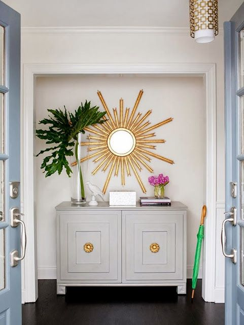add some starburst shine over console in all white entryway
