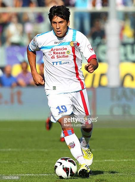 Lucas Nahuel Castro of Calcio Catania in action during the Serie A match between ACF Fiorentina and Calcio Catania at Stadio Artemio Franchi on...