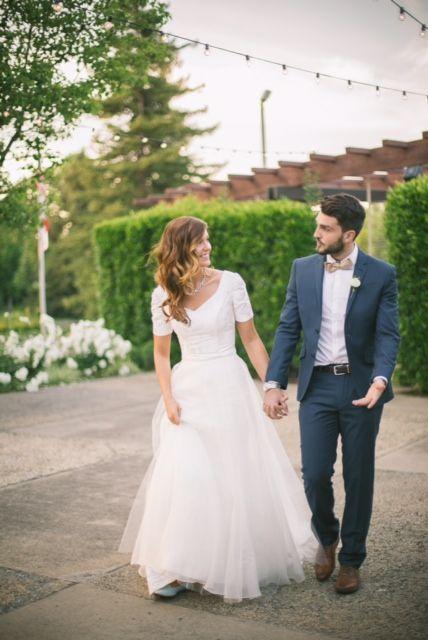 Modest wedding dress by Alta Moda.  Photo: Emma Vidmar