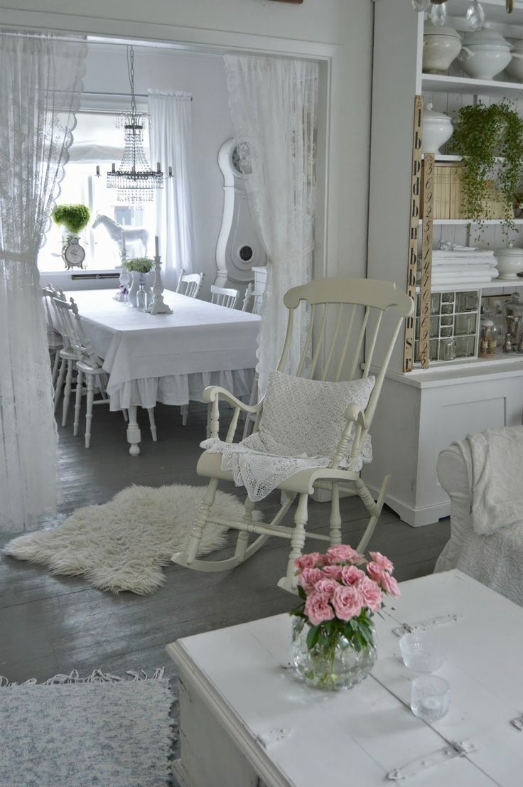 LOVE that shabby chic look with those lace curtains on the kitchen doorway ♥