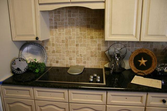 Off white cabinets with black granite countertops for Off white cabinets with granite countertops