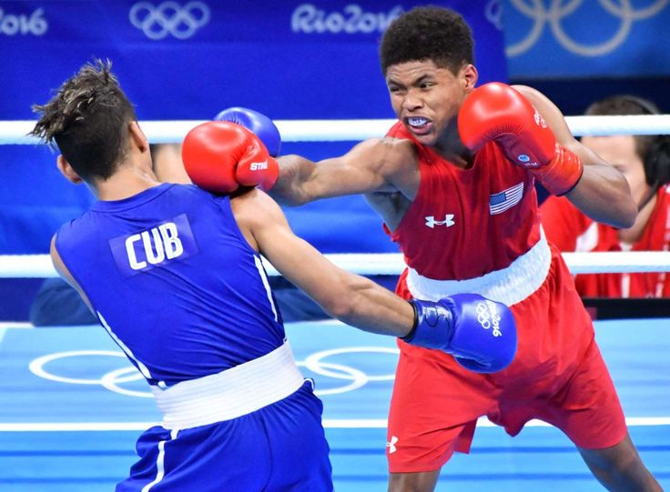 Shakur Stevenson of the United States throws a punch against Robeisy Ramirez of Cuba during their men's bantamweight gold medal bout at the Rio 2016 Summer Olympic Games at Riocentro - Pavilion 6.     -  Best images from Aug. 20 at the Rio Olympics