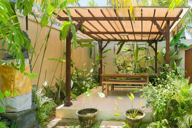 Villa Ahh in Ubud features beautiful outside eating areas.