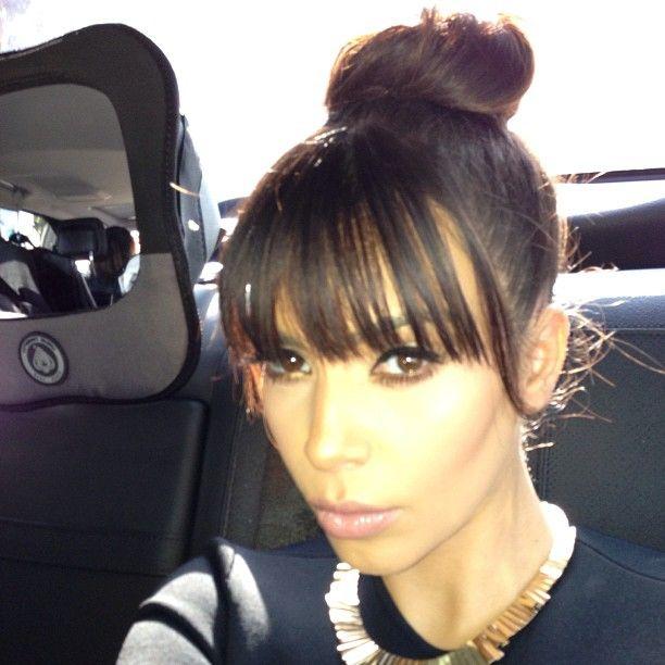 Kim k topknot and bangs - perfect!