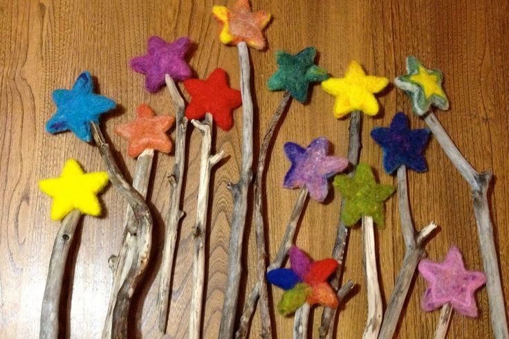 magic wand made of a natural branch or a straight wood stick and a felted star