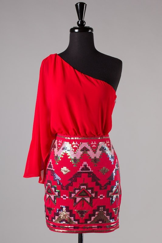 Kiss My Chic Aztec Sequin Dress in Red $49.00 Kiss, Kiss! All eyes will be on you in this stunning red dress. Featuring a flowing one shoulder top and Aztec tribal sequins on the stretch bottom portion of the dress. Pair it with a nude pump and simple accessories. Top is lined.