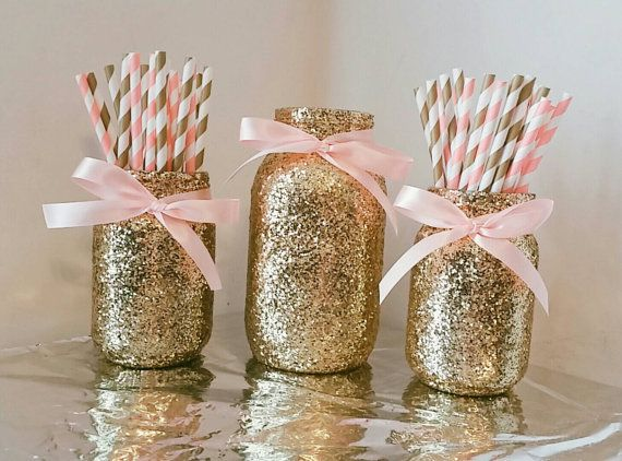 This listing will provide you with a set of 3 glass glitter mason jars decorated with gold glitter and satin bows around the mouth of the jar.  limited quantities available of this set.  In this set you will receive 2 pint sized jars and 1 quart sizes jar.   Choose a different color paper straw combo and ribbon color.  Gold Straws may vary in design depending on what is in stock (stripes, polka dot, and chevron combos!)  Ribbon color available options: Light Pink, Bright Pink, Blue, Red…