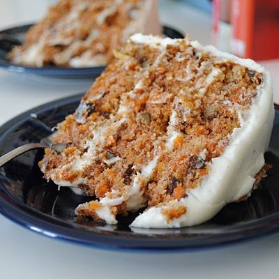 Hands down, best Carrot Cake I've ever had IN MY LIFE! I didn't follow this recipe for the frosting, instead I made some homemade cream cheese icing with two softened bars of cream cheese, 1/2 cup of softened of butter, 2 cups of confectioner's sugar, and two splashes of vanilla and mix. That stuff tastes like cheesecake batter instead of gross, too sugary frosting. SO good!
