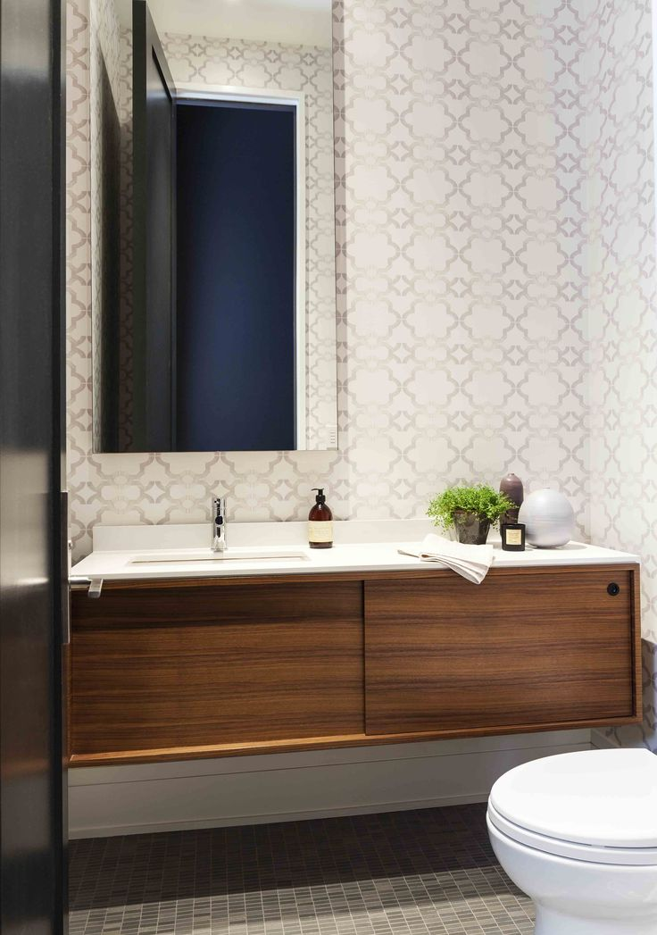 Bathroom with teak cabinet by Mazen Studio, Toronto