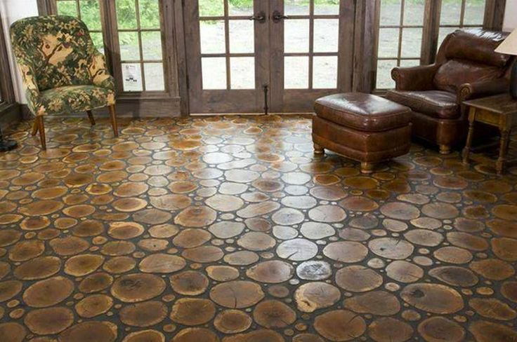 Earthen floors are becoming more popular and here we have a beautiful cordwood or log end floor. This photo comes to us courtesy of Burger Jewell Ltd. The materials are reclaimed and sealed wood from www.facebook.com/OwnerBuilderNetwork