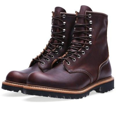 Originally built to equip Lumberjacks who needed a piece of footwear tough enough to take the dangers involved in clearing America's forests, the Red Wing 4585 is a classic logger boot and a serious piece of kit. Made from Briar Oil Slick leather, it is constructed with a tough steel shank for incredibly rigidity and a rugged Goodyear welted Vibram Lug sole unit. A true workwear icon.  Briar Oil Slick Leather Uppers Round Toe Goodyear Welt Construction Metal Eyelets and Hiking Lacing Hard...