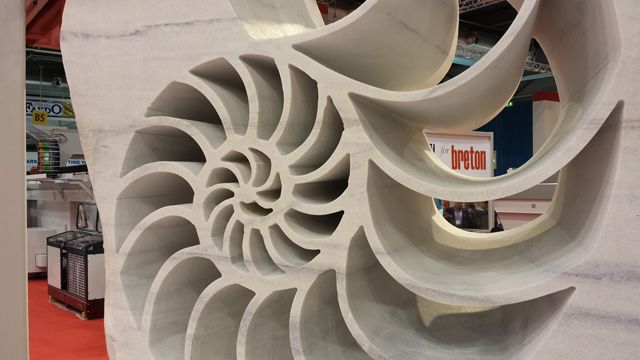 "Sculpture ""Nautilus"" produced by KIENESBERGER's ""FUEGO"" at the 50th Marmomacc 2015. ~ Breton stone machinery"