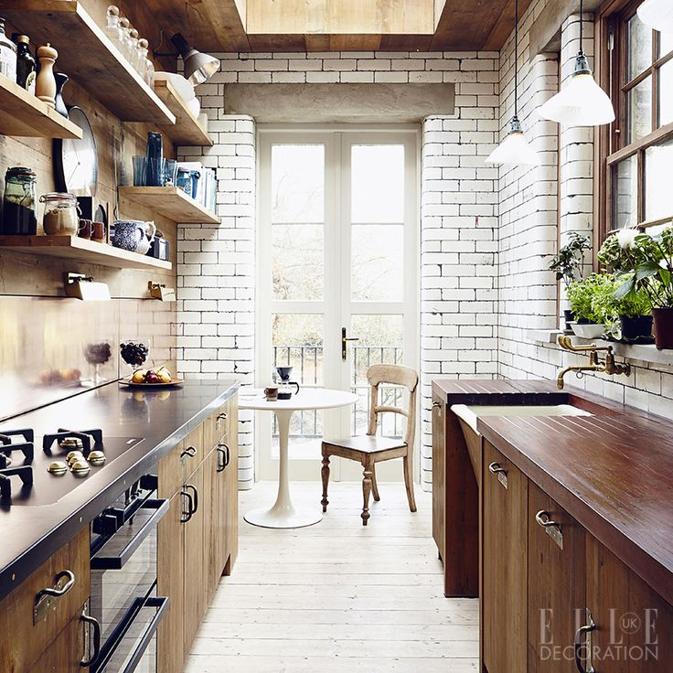 A new extension to a 19th-century London property houses this kitchen, which has been designed with salvaged pieces from Retrouvius. The cabinetry is vintage pine and reclaimed bullnose glazed bricks clad the walls throughout (retrouvius.com)<span>Photography: Jake Curtis</span>