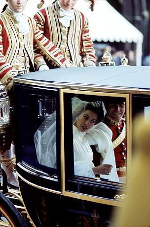 Princess Anne and Capt. Mark Philips returning to Buckingham Palace after the wedding ceremony.