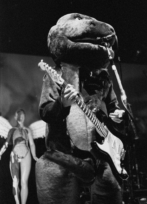 Kurt Cobain dressed as Barney the Dinosaur during a live Halloween show in Akron, Ohio, 1993.