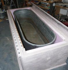 Solar Horse Tank could be a model for a baptistery where the tank is inside and a simple wooden box frames it. Can be filled for baptisms and a drain put on bottom to drain