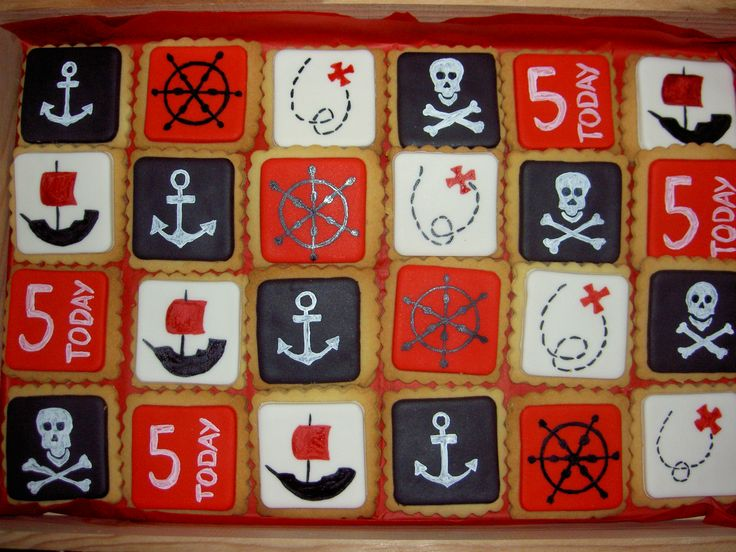 Pirate themed hand painted biscuits.