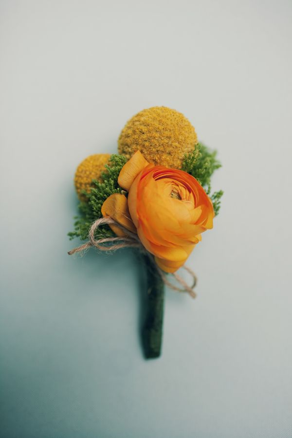 Great boutonniere -- not a flower expert but i think the yellow globes are craspedia, and what's the orange one?