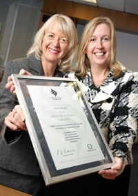 Ruth James and Sue Barnes of TNT with IIP award